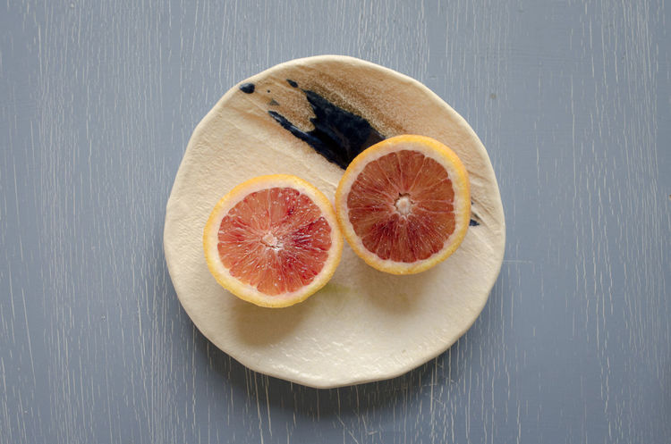 Blood Orange Citrus Fruit Close-up Cross Section Day Food Food And Drink Freshness Fruit Grapefruit Halved Healthy Eating High Angle View Indoors  No People SLICE Table