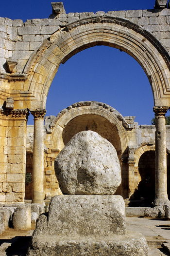 Simeon Stylites church before civil war. Ancient Ancient Civilization Arch Arched Architecture Blue Sky Building Exterior Built Structure Church Clear Sky Day History Monestary No People Old Ruin Outdoors Pilar Saint Simeon Stylites Sky Symeon The Stylite Weathered