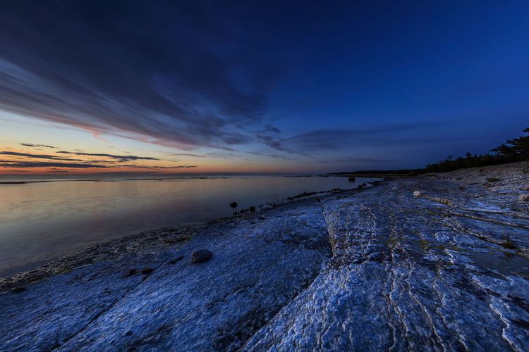Summer sunset at Neptuni fields at the northern part of the Swedish island of Öland Beautiful Nature Blue Hour Calm Calmness Serenity Sweden Calm Water Clouds And Sky Limestone No People Ocean Sea Sea And Sky Summer Sunset Vibrant Color Öland