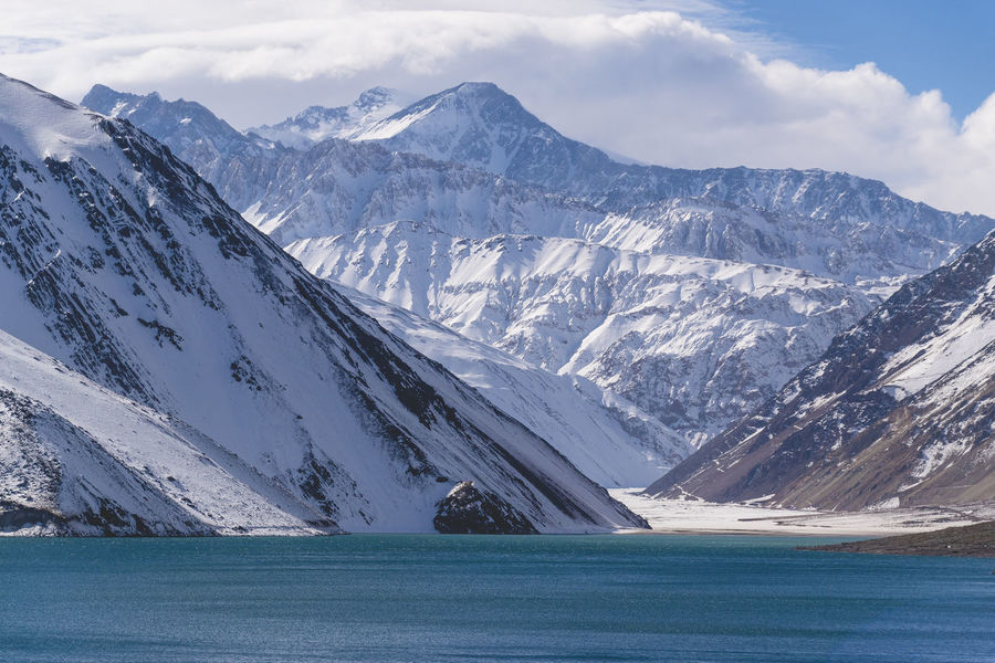 Beauty In Nature Childhood Cold Temperature Day Embalse El Yeso Lake Landscape Mountain Mountain Range Nature No People Outdoors Scenics Sky Snow Snowcapped Mountain Tranquil Scene Tranquility Water Winter The Great Outdoors - 2017 EyeEm Awards 100 Days Of Summer