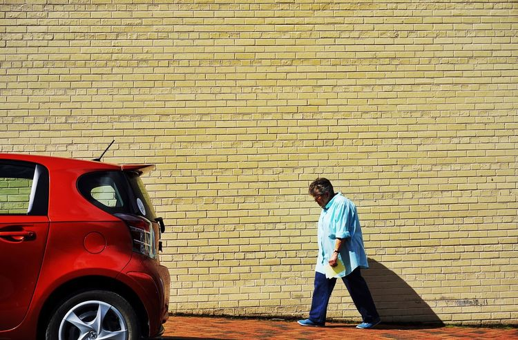 The little one Up Against The Wall Wall Brick Wall Yellow People Watching Peoplephotography Light And Shadow The Weekend On EyeEm The Street Photographer - 2015 EyeEm Awards Creative Light And Shadow