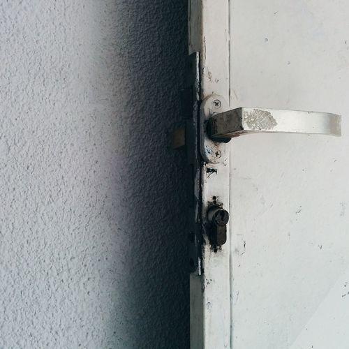 Close-up Day Door Door Handle Door Lock Doors Doorway Key Lock Minimal No People Old Door Outdoors Rust Rusty Shadow Shadowplay Simple Wall White The Graphic City