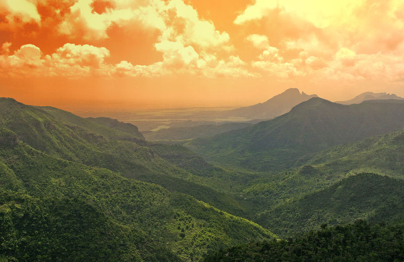 Mountain range and valley on the island of Mauritius - Indian Ocean Sunset Nature Sky Landscape Day Outdoors Tranquility Mountain Scenics Beauty In Nature No People Greenery Scenery Tranquil Scene Mountain Range Valley View Orange Glow Mauritiusisland Been There. Lost In The Landscape Perspectives On Nature Colour Your Horizn Go Higher The Great Outdoors - 2018 EyeEm Awards The Traveler - 2018 EyeEm Awards