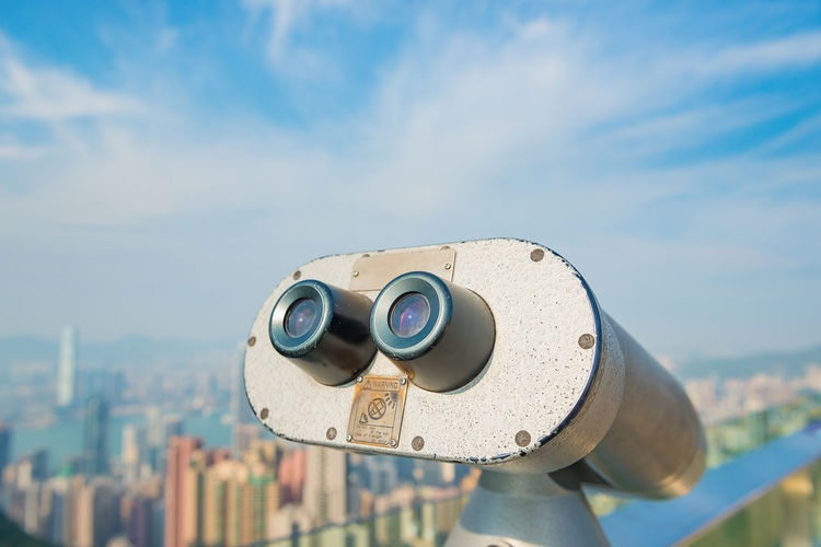 Binoculars Coin Operated Sky Surveillance Coin-operated Binoculars Building Exterior Security Architecture Technology Focus On Foreground Close-up Day Nature Cloud - Sky Built Structure Scrutiny City Outdoors Optical Instrument Landscape Cityscape No People Astronomy Hand-held Telescope Skyscraper