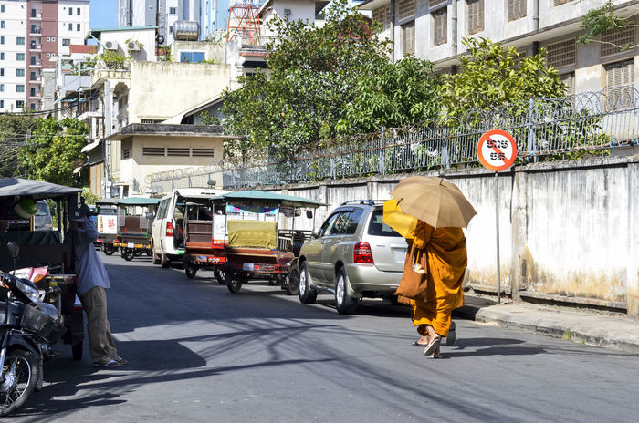 Life of Phom Penh Adult Adults Only ALMS Austerities Day Life Monks Monks Walk One Person Outdoors People Phnom Penh Streetphotography