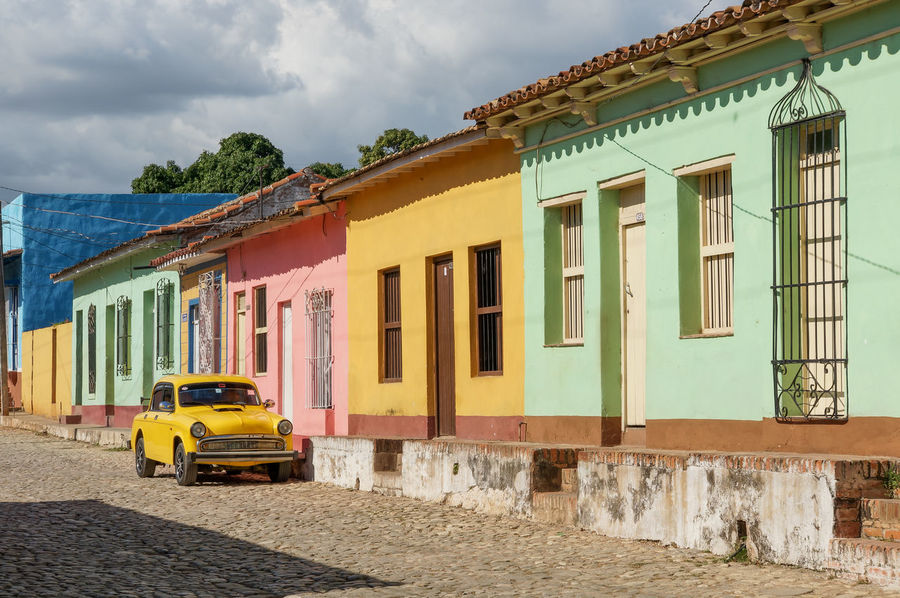 Colors Cuba Collection EyeEm EyeEm Selects EyeEm Gallery EyeEmNewHere Fun Cars Trinidad Architecture Building Exterior Built Structure Cloud - Sky Day Land Vehicle Sky Streetphotography Transportation Travel Destinations Yellow