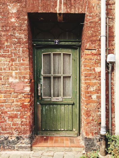 Building Exterior Architecture Built Structure Brick Wall Door Closed House Entrance Brick Day Outdoors Red Façade No People Entryway Green Color History