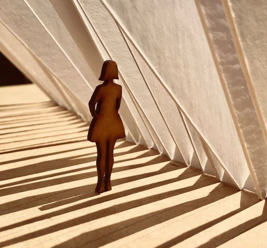 Close-up of woman figurine in building