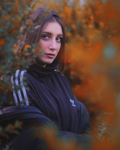 Portrait of a beautiful young woman during autumn