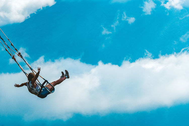 Blues Swinging Adventure Blue Sky Cloud - Sky Ecuador Excitement Exhilaration Low Angle View Mid-air Motion Outdoors People Sky Swing Swinging High Up In The Air Up In The Sky