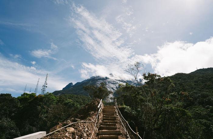 Mount Kinabalu Beauty In Nature Cloud - Sky Day Footbridge Mountain Mountain Range Nature No People Outdoors Scenics Sky The Way Forward Tranquil Scene Tree