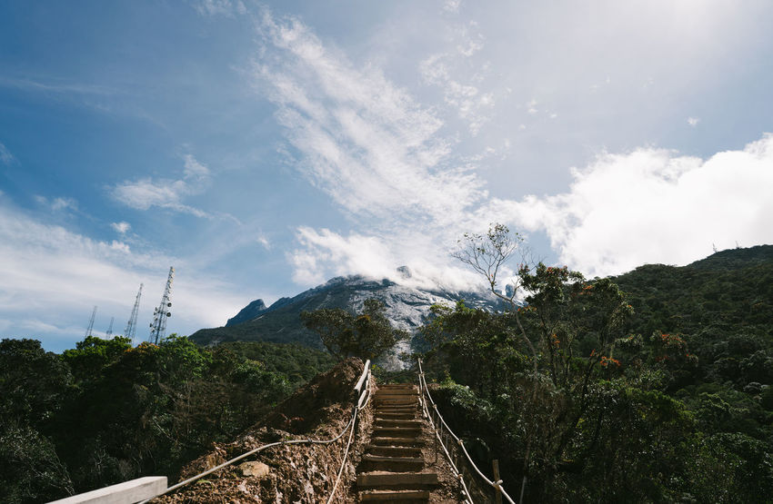 Mount Kinabalu Beauty In Nature Cloud - Sky Day Footbridge Mountain Mountain Range Nature No People Outdoors Scenics Sky The Way Forward Tranquil Scene Tree