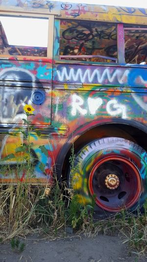 Graffiti on old rusty car