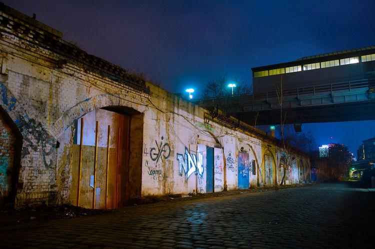 old S-Bahnbögen on the U-Bahnhof Gleisdreieck by night Architecture Berlin Blue Building Built Structure Dark Diminishing Perspective Grafitty Illuminated Lighting Equipment Night No People Outdoors S-Bahnbogen Sky Street Light The Way Forward U-Bahnhof Gleisdreieck Vanishing Point