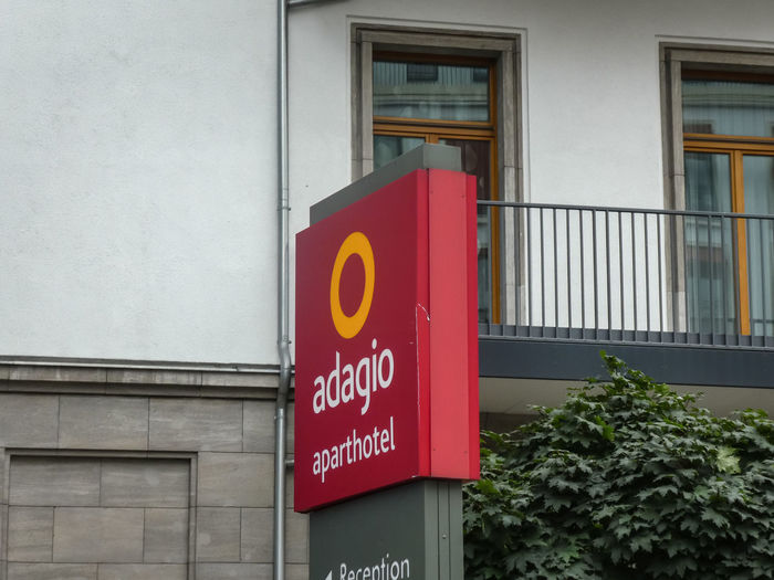 Aparthotel Adagio signage, hotel located on Lietzenburger Street, close to the the world-famous Kurfürstendamm shopping mile in the heart of West Berlin Berlin Travel Travelling Accommodation Adagio Aparthotel Building Building Exterior Built Structure Communication Hotel Information Information Sign No People Outdoors Reservation Sign Text Western Script