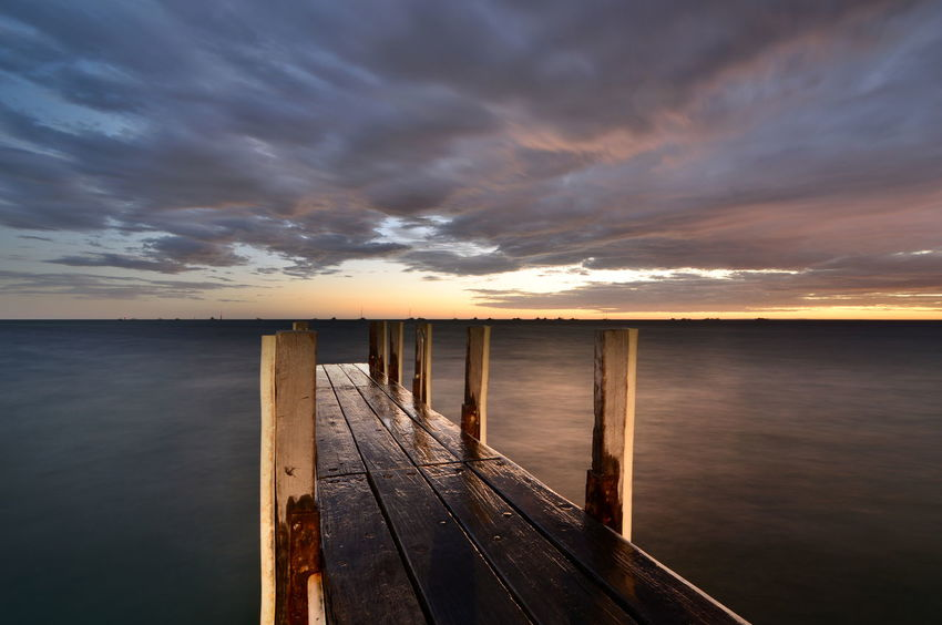 Scenic sunset at old pier. Denham. Shark Bay. Western Australia Australia Australian Landscape Shark Bay Australia Western Australia WesternAustralia Aussie Beauty In Nature Cloud - Sky Coral Coast Denham Dusk Horizon Horizon Over Water Idyllic Monkey Mia Nature No People Outdoors Pier Scenics - Nature Sea Sunset Sunsetporn Tranquil Scene Wood - Material