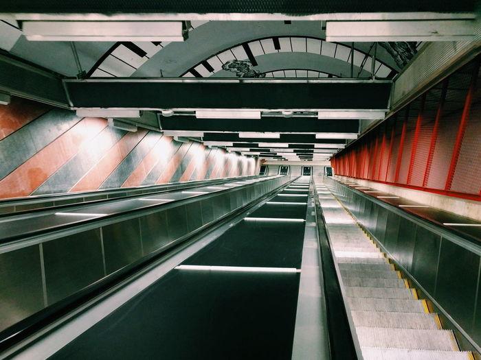 Escalator And Moving Walkway At Subway Station