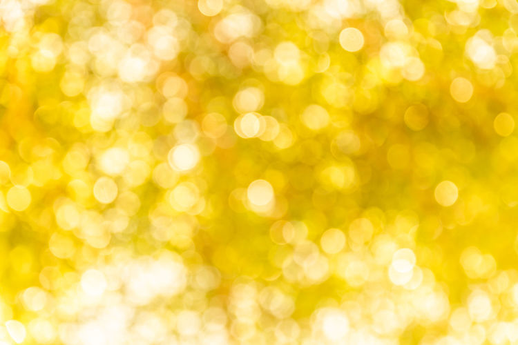 Backgrounds Shiny Yellow Holiday Bright Vibrant Color Defocused Decoration Abstract Christmas Gold Colored Brightly Lit Glitter Event No People Gold Celebration Holiday - Event Circle Textured Effect Ornate Clean Abstract Backgrounds Bokeh