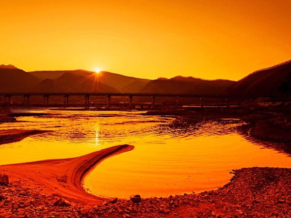 Sunset Nature Beauty In Nature Orange Color Scenics Tranquil Scene Outdoors Tranquility Sand No People Landscape Water Mountain Sunlight Sky Day Salt - Mineral