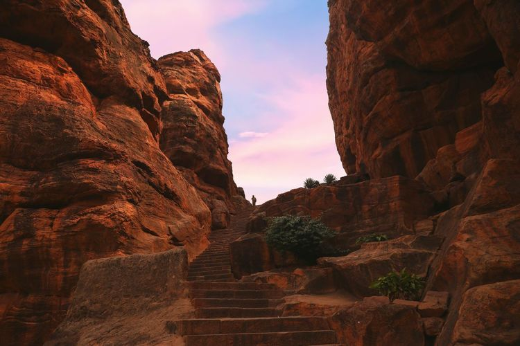 Low angle view of rock formations at sunset
