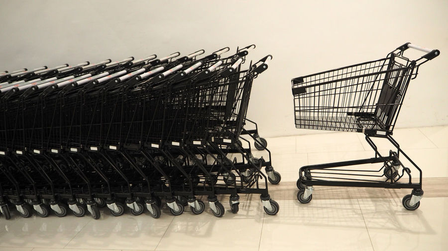 Convenience Isolated Supermarket Trolley Absence Arrangement Black Consumerism Day Empty Flooring Hypermarket In A Row Indoors  Large Group Of Objects Metal No People Order Repetition Retail  Shopping Shopping Cart Side View Steel Supermarket Trolley
