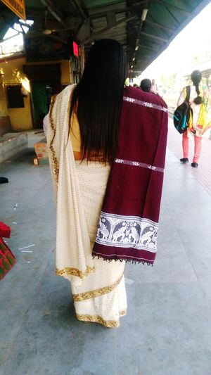 A Bengali Lady Wearing Traditional Indian Saree Accompanying With Shawl