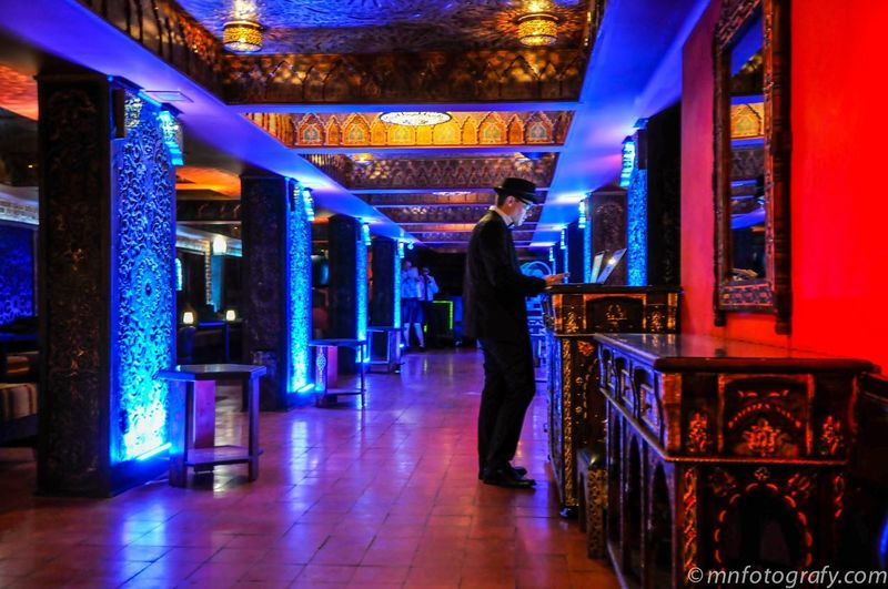 Blue Hall Full Length Lifestyles Men Indoors  Illuminated Walking Leisure Activity Casual Clothing Architecture Shop Person Retail  Culture Place Of Worship Narrow