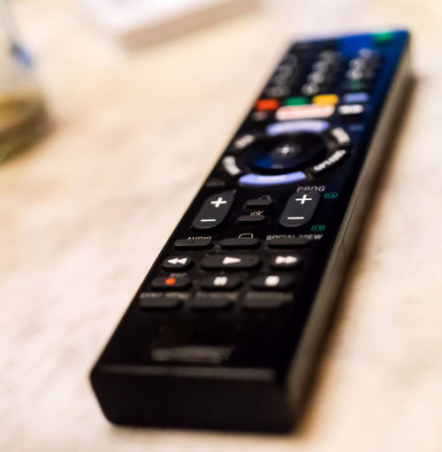 Intentionally blurred abstract photo of a remote control Button Channel Switch Blurry Close-up Communication Connection Control Day Device Electronics Industry Entertainment Focus Indoors  Keypad Macro No People Program Push Remote Control Table Technology Television Video Wireless