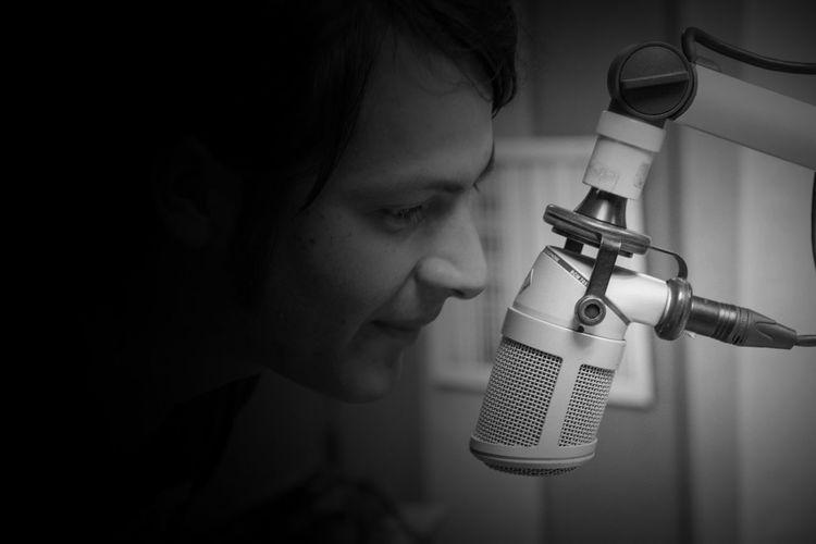 Close-up of radio jockey talking on microphone