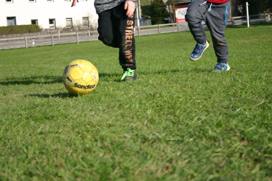Low Section Human Leg Human Body Part Grass Only Men Men Two People Soccer Ball Soccer Adults Only Sportsman People Kicking Adult Sport Outdoors Soccer Field Playing Close-up Ball Vorchdorf Children Playground Day Dirty Shoes