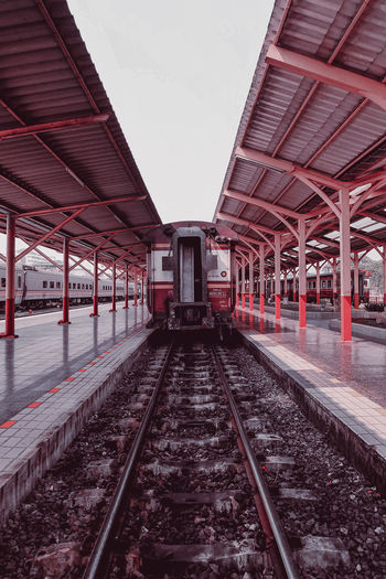 View of train on railroad station platform against sky