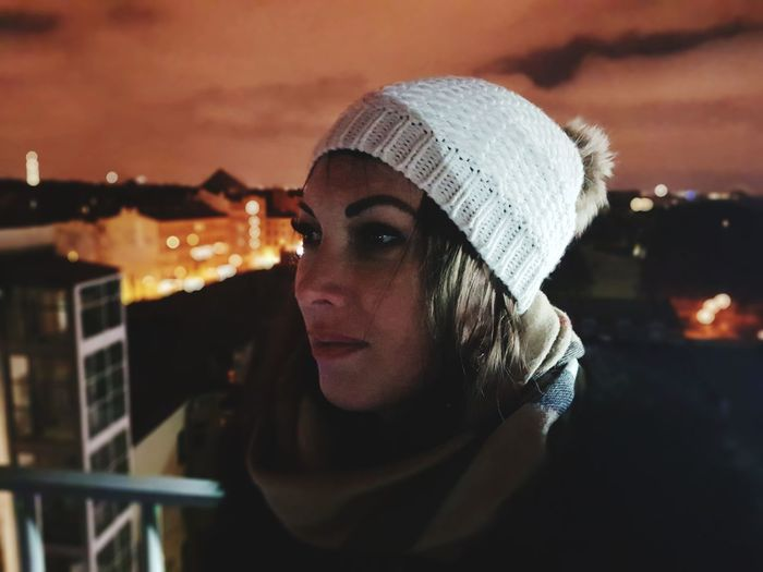 Close-Up Of Young Woman Against Sky At Night