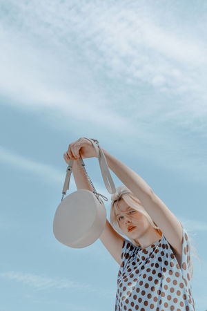 One Person Sky Cloud - Sky Women Real People Lifestyles Casual Clothing Leisure Activity Nature Females Arms Raised Bag Lady Bags Leather Bag Blue Sky Editorial  Fashion Editorial TheWeekOnEyeEM The Week on EyeEm