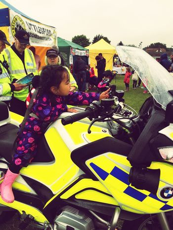 ElsenhamVillageFete Daughter checking out the police equipment