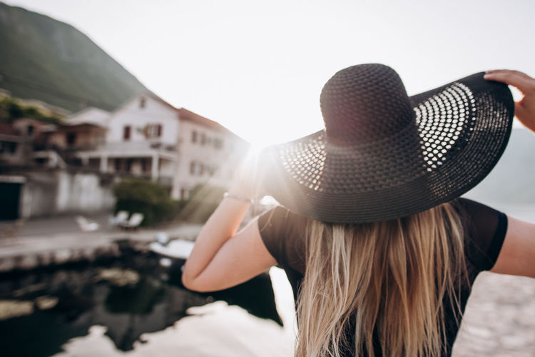 Portrait of woman with hat against sun