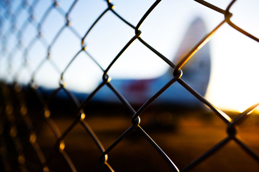 Blue Sky Bokeh Bokeh Photography Reflection Shine Sunset Collection Sunshine Wire Mesh Fence