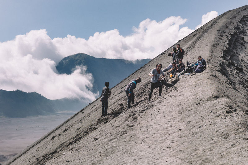 Cheerful Hikers At Mt Bromo Against Sky