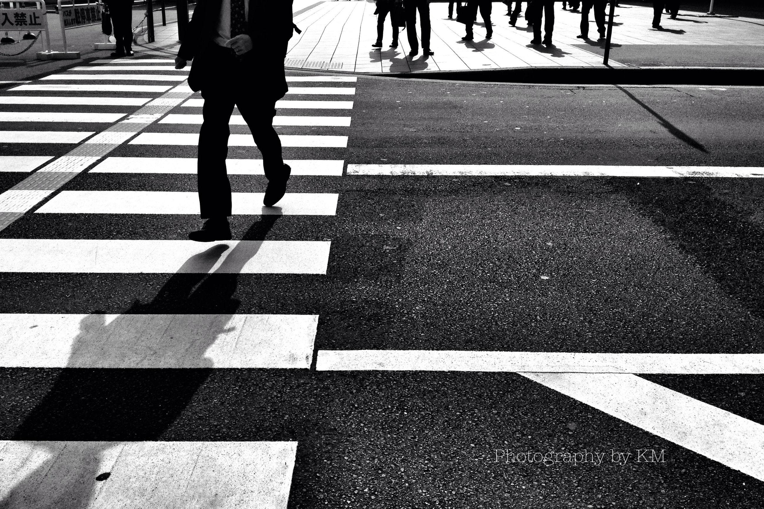 road marking, street, road, zebra crossing, walking, transportation, low section, asphalt, shadow, men, lifestyles, city life, person, sunlight, crosswalk, the way forward, crossing