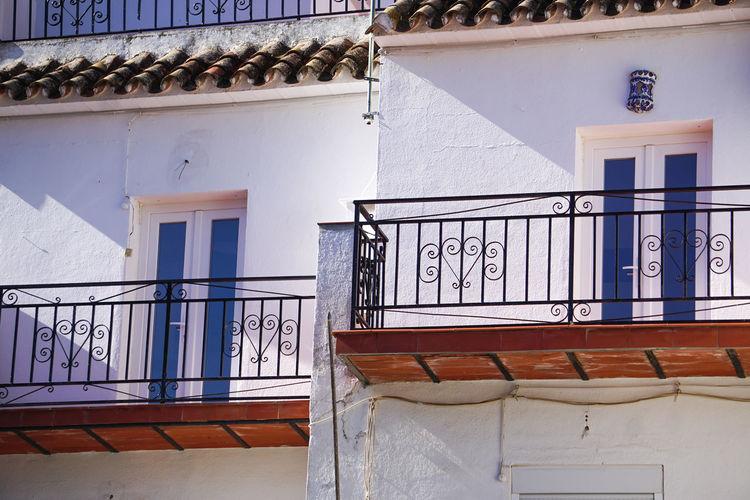 Whitewashed house with balcony