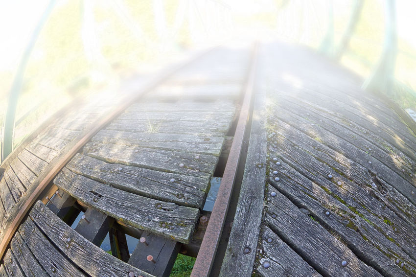 Railway Bridge Architecture Bench Bridge Close-up Day Focus On Foreground High Angle View Land Nature No People Old Outdoors Park Bench Pattern Plank Plant Railway Railway Bridge Seat Selective Focus Sunlight Table Wood Wood - Material