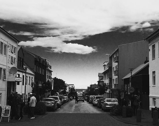 Architecture City City Life City Street Cityscape Cloud Dramatic Sky Perspective Road Black And White Building Exterior Car City Wiew Distant View Dramatic Sky At Sunset Time Land Vehicle Mode Of Transport Outdoors Real People Road Street Street Photography The Way Forward Travel Destinations Vehicle