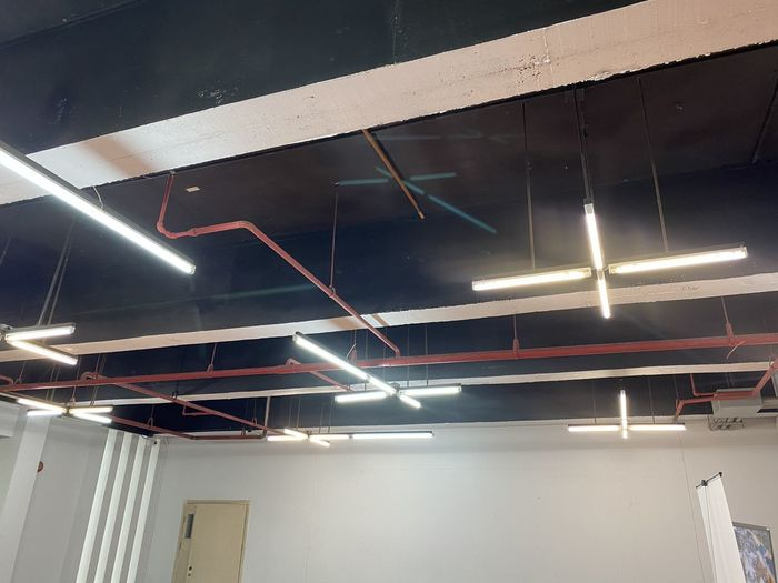 Low angle view of illuminated lights in building