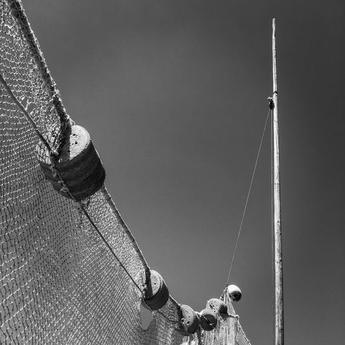 Low section of man fishing