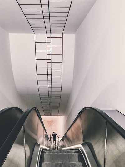 TakeoverContrast Indoors  Railing Escalator Men Walking High Angle View Low Section Convenience Sitting Steps Ceiling On The Move Staircase Flooring Person Resting Elevated View Stairs Vienna Austria Albertina