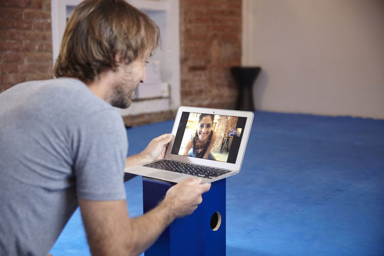 Man video conferencing at home