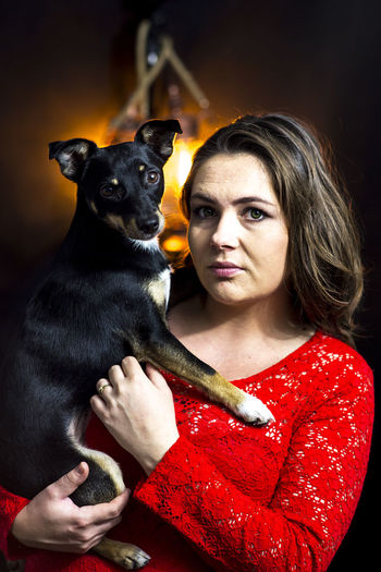 Dog Dog Love Domestic Animals Holding Looking At Camera One Animal One Light Source One Person One Woman Only Only Women Portrait Real People Red Red Clouds Studio Shot