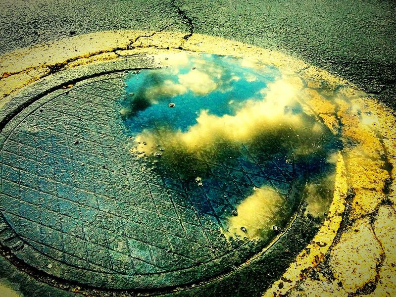Great capture of clouds on manhole cover. EyeEmBestPics Beautiful Day Puddle Reflections PuddleWonderful Puddlegram Puddleporn Puddles Check This Out Taking Photos Better Look Twice EyeEm Gallery EyeEm Best Edits Eyeemphotography EyeEm Best Shots - Reflections Showcase: January Colorsplash Color Splash 43 Golden Moments Colour Of Life The City Light Art Is Everywhere Colour Your Horizn