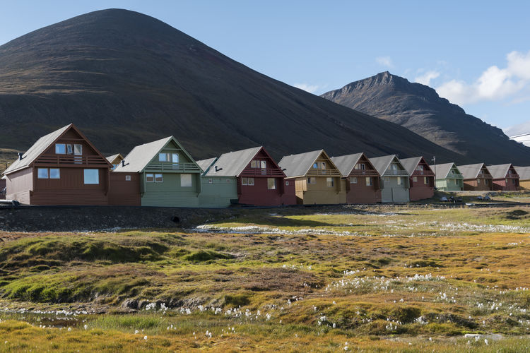 Longyearbyen's houses Architecture Blue Sky Building Exterior Built Structure Colorful Houses Countryside Day EyeEmNewHere Grass Green Grass House Houses Landscape Longyearbyen Mountain No People Northern Norway Norway Outdoors Sky Small Town Spitsbergen Summer Summer Views Svalbard  Miles Away Miles Away