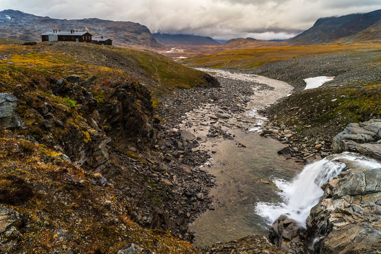 September hiking along The King's Trail in northern Sweden Autumn Beauty In Nature Cabins  Calm Cottage Fall Hiking Hill Idyllic Kungsleden Landscape Mountain Nature Northern Europe Outdoors Remote Rock Scandinavia Stream Sweden The Kings Trail Tranquility Vacations Water Waterfall