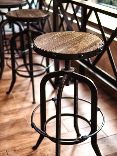Close-up of empty chairs and table in restaurant
